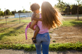 Beautiful young mother with her son having fun in the park. - PhotoDune Item for Sale
