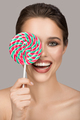 Cheerful Smiling Woman With Big Colorful Lollipop. - PhotoDune Item for Sale