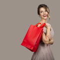 Cheerful Woman In Evening Dress Holding Red Shopping Bags. - PhotoDune Item for Sale