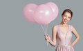 Portrait Of Smiling Woman. Holding Pink Balloons In Her Hand. - PhotoDune Item for Sale