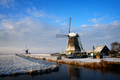 Windmills in the snow in a winter landscape at sunrise - PhotoDune Item for Sale