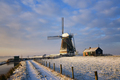 Path towards a windmill in the snow in a dutch winter landscape - PhotoDune Item for Sale