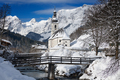 Ramsau church with Alps mountains in the snow in winter - PhotoDune Item for Sale