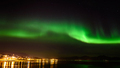 A beautiful green Aurora borealis or northern lights in the sky at Tromso, Norway - PhotoDune Item for Sale