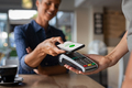 Woman paying using NFC technology - PhotoDune Item for Sale