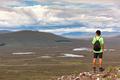 Scottish highland landscape: boy hiking in Glencoe mountain. Scotland, UK, Europe. - PhotoDune Item for Sale