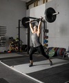 Strong femal weight lifter with heavy weights over her head, two thirds profile shot. - PhotoDune Item for Sale