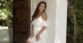 Attractive young brunette in white dress standing next to wall - PhotoDune Item for Sale