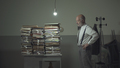 Business executive staring at the stacked paperwork on his desk - PhotoDune Item for Sale