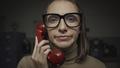 Woman having a boring phone call - PhotoDune Item for Sale