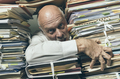 Panicked businessman overloaded with paperwork - PhotoDune Item for Sale