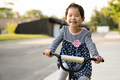 Cute little girl learning ride a bicycle with no helmet - PhotoDune Item for Sale