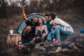 Young friends laughing, taking selfie,hanging out at campsite - PhotoDune Item for Sale