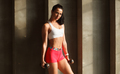athletic attractive female posing with dumbbells near concrete wall - PhotoDune Item for Sale