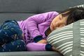 Little Asian child taking nap on couch - PhotoDune Item for Sale