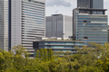 Modern architecture. Modern steel and glass skyscrapers in Osaka - PhotoDune Item for Sale