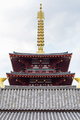 Top of pagoda tower on light background with clouds - PhotoDune Item for Sale