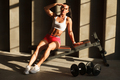 fit female relaxing on sportive bench in gym - PhotoDune Item for Sale