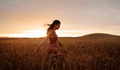 Carefree female strolling in the wheat field - PhotoDune Item for Sale
