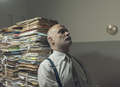 Stressed business executive overloaded with paperwork - PhotoDune Item for Sale