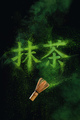 Kanji Matcha written in matcha powder with a bamboo whisk flying in the air. Japanese drink concept - PhotoDune Item for Sale