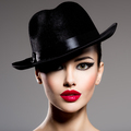 Сlose-up portrait of a woman in a black hat  with red lips - PhotoDune Item for Sale