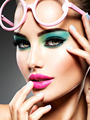 Beautiful Face of a woman with green vivid make-up of eyes - PhotoDune Item for Sale