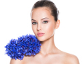 Face of a beautiful girl  with blue posy fild flowers. - PhotoDune Item for Sale
