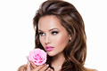 Face of a beautiful  woman with long brown hairs and pink flower - PhotoDune Item for Sale