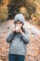 Little girl drinks tea in the autumn park - PhotoDune Item for Sale