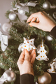 hands decorating christmas tree with christmas tree toys - PhotoDune Item for Sale