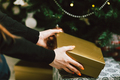 hands take gift box under christmas tree - PhotoDune Item for Sale