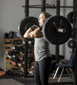 Strong young woman in gym struggling with heavy weights. - PhotoDune Item for Sale
