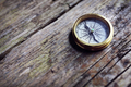 Antique golden compass on wood background - PhotoDune Item for Sale