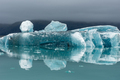 Melting icebergs as a result of global warming floating in Jokulsarlon glacial lagoon. Iceland - PhotoDune Item for Sale