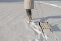 Winter boots on snow near sledge with rope - PhotoDune Item for Sale