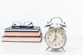 Alarm clock with old book with eyeglasses-2 - PhotoDune Item for Sale