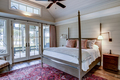 Beautiful luxury bedroom with view out onto waterfront and river. - PhotoDune Item for Sale