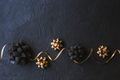 Gold and black bow for gift box on a black background. Christmas. - PhotoDune Item for Sale