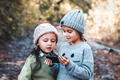 Children in the background of nature play with smartphone. Watch the video and have fun. Friendship - PhotoDune Item for Sale