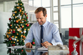 Businessman working on digital tablet at christmas - PhotoDune Item for Sale