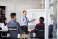 Businessman giving presentation with colleagues - PhotoDune Item for Sale