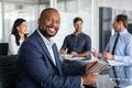 Mature african businessman at meeting - PhotoDune Item for Sale