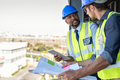 Construction workers discussing blueprint - PhotoDune Item for Sale