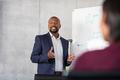 Mature african businessman training employees - PhotoDune Item for Sale