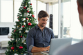 Businessman working during christmas time - PhotoDune Item for Sale