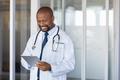African doctor using digital tablet at hospital - PhotoDune Item for Sale