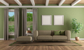 Green living room with modern sofa and footstool - PhotoDune Item for Sale