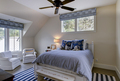 Beautiful upstairs spare bedroom with neutral colors and windows. - PhotoDune Item for Sale