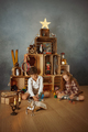 Two Kids Playing With Toys Near the Christmas Tree - PhotoDune Item for Sale
